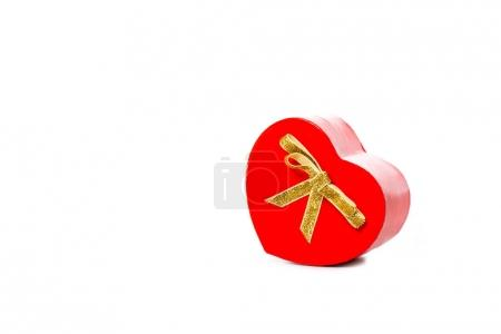 close-up view of red heart shaped gift isolated on white