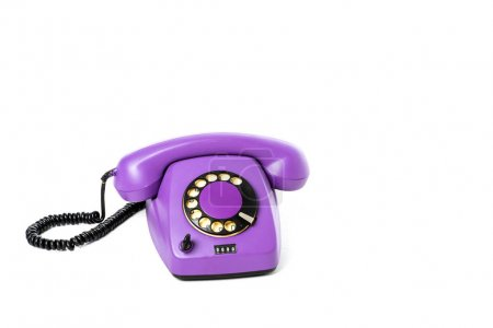 close-up view of purple rotary telephone isolated on white