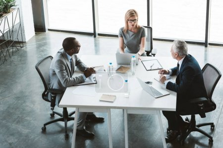 high angle view of professional multiethnic business people having conversation during business meeting