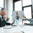 professional multiethnic business people having conversation during business meeting