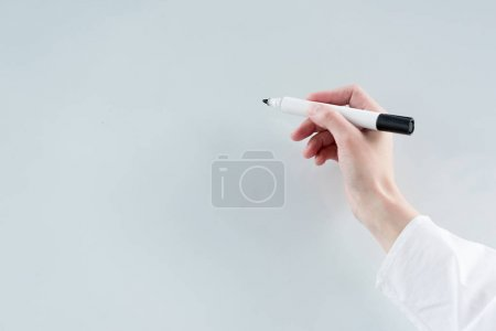 close-up partial view of buisnesswoman writing on blank whiteboard