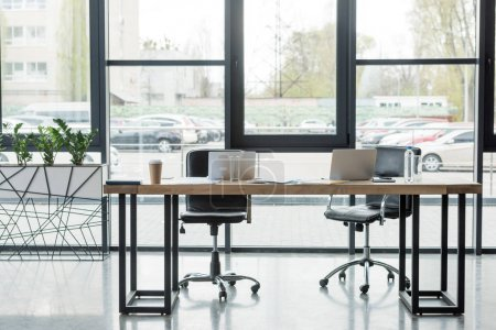 laptops on table in empty business office