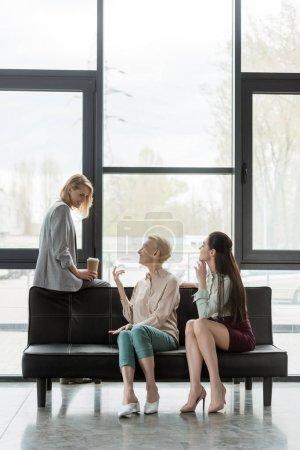 beautiful businesswomen talking during coffee break in office