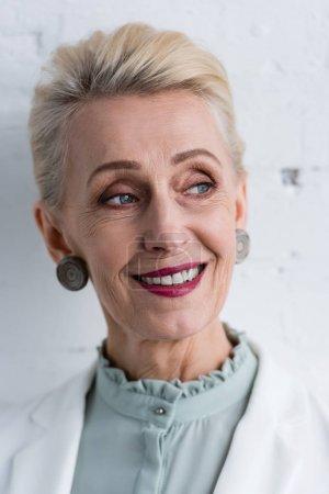 Photo for Portrait of smiling senior stylish businesswoman - Royalty Free Image