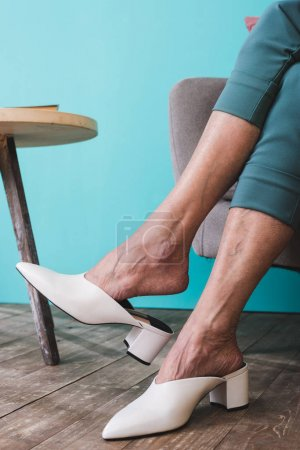 low section view of senior woman in white shoes