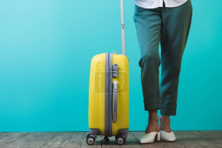 Photo for Cropped view of woman with yellow travel bag - Royalty Free Image