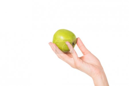 cropped shot of woman holding green apple isolated on white background
