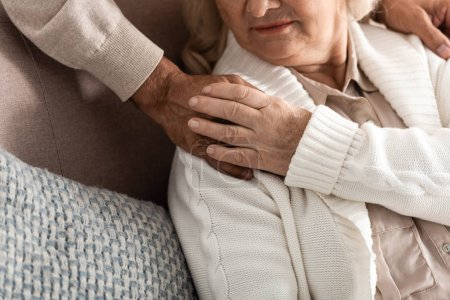 Photo for Cropped view of senior woman touching hand on husband - Royalty Free Image
