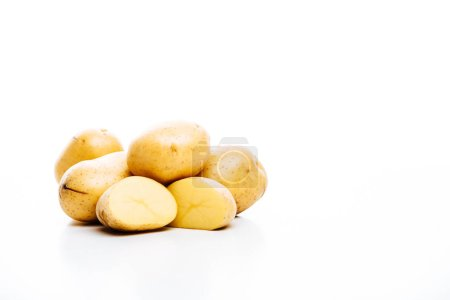 Photo for Raw whole and cut fresh potatoes isolated on white - Royalty Free Image
