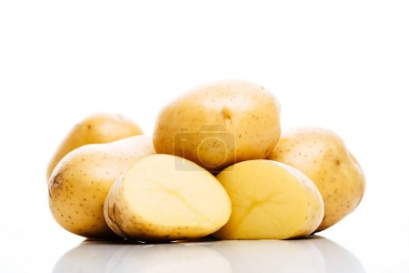 raw whole and cut fresh potatoes isolated on white