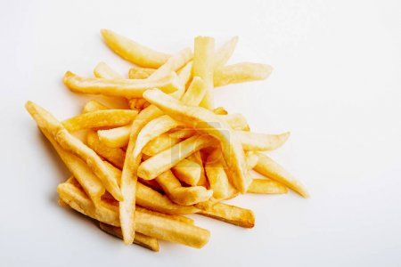 heap of fresh golden french fries on white background