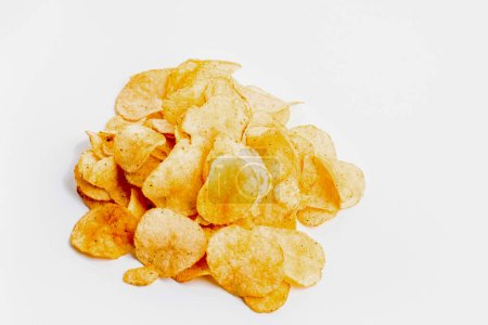 Photo for Heap of fresh crunchy potato chips on white background - Royalty Free Image
