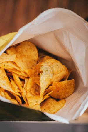 close up view of delicious crispy potato chips in package