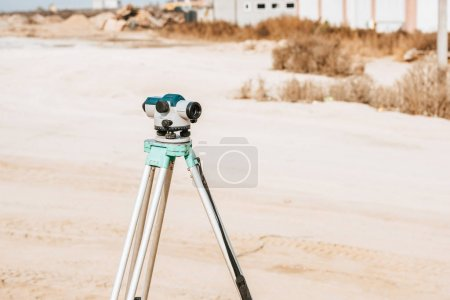 Photo for Digital level for geodesy measuring on dirt road - Royalty Free Image
