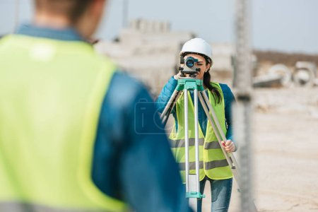 Photo for Selective focus of surveyors using digital level and survey ruler - Royalty Free Image