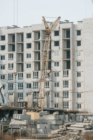 Photo for Construction site with crane and concrete blocks - Royalty Free Image