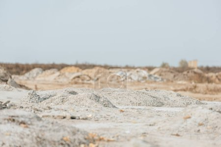 Photo for Sand molds and slag in field with sky at background - Royalty Free Image