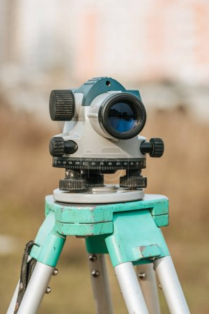 Photo for Digital level for geodesy measuring on tripod - Royalty Free Image