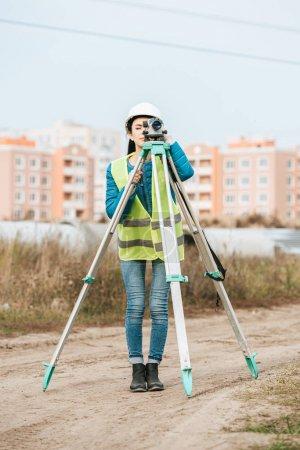 Photo for Female Surveyor measuring land with digital level - Royalty Free Image
