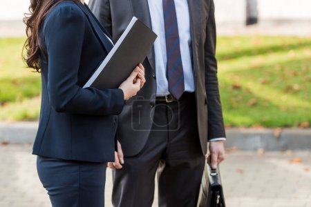 Photo for Cropped view of ambassadors in suits standing outside - Royalty Free Image