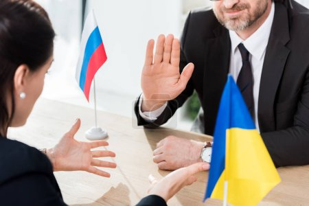 Photo for Cropped view of ukrainian diplomat and ambassador of russia gesturing during negotiation - Royalty Free Image