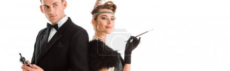panoramic shot of handsome man holding gun near attractive woman isolated on white