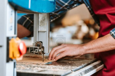 Photo for Selective focus of carpenter using electric woodworking - Royalty Free Image