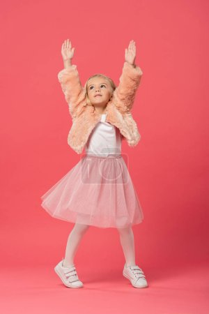 Photo for Cute and stylish kid in with outstretched hands on pink background - Royalty Free Image