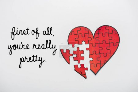 Photo for Top view of drawn red heart shape puzzles near first of all youre really pretty letters on white - Royalty Free Image