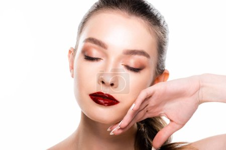Photo pour Attractive young woman touching face with closed eyes isolated on white - image libre de droit