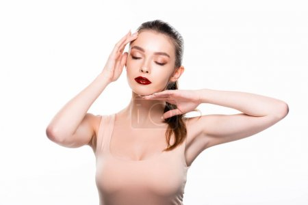 Photo for Attractive young woman touching face with closed eyes isolated on white - Royalty Free Image