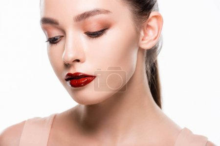 Photo pour Beautiful young woman with makeup and bright red lips isolated on white - image libre de droit