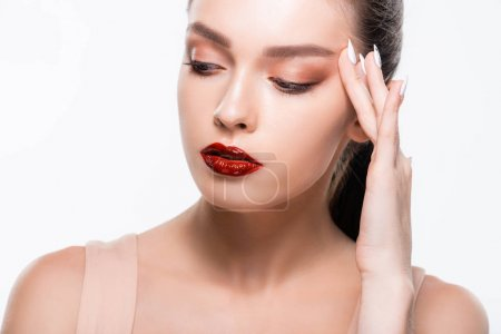 Photo pour Attractive girl with red lips and makeup touching face isolated on white - image libre de droit