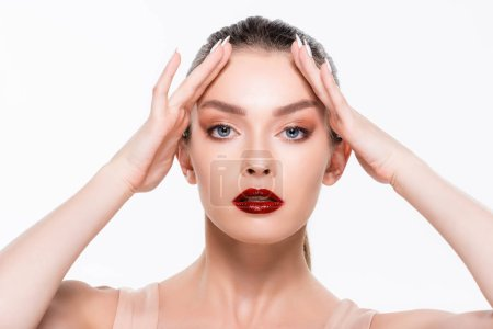 Photo pour Attractive girl with red lips touching forehead isolated on white - image libre de droit