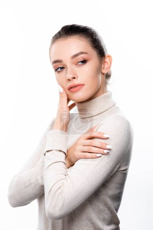 Photo pour Beautiful girl with natural makeup touching face and looking away isolated on white - image libre de droit