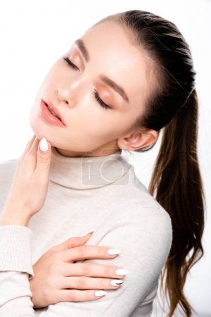 Photo pour Attractive girl with natural makeup touching face with closed eyes isolated on white - image libre de droit