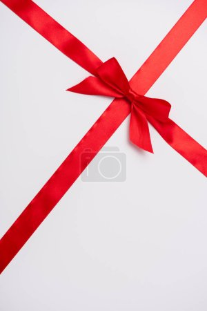 Photo for Satin ribbon with red decorative bow isolated on white - Royalty Free Image