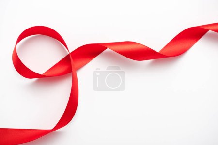 Photo for Top view of satin and curled ribbon on white with copy space - Royalty Free Image
