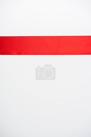 top view of flat red ribbon isolated on white
