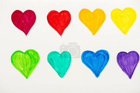 Photo pour Painted and colorful hearts isolated on white - image libre de droit