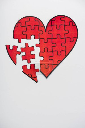 Photo for Top view of drawn red heart shape jigsaw isolated on white with copy space - Royalty Free Image