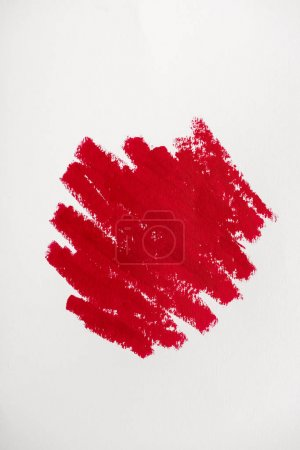 Photo for Top view of red drawn stroke with red lipstick isolated on white - Royalty Free Image
