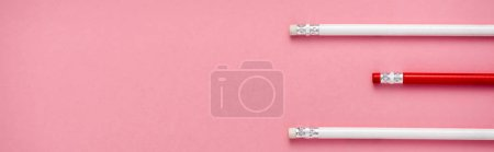 Photo pour Panoramic shot of erasers on pencils isolated on pink - image libre de droit