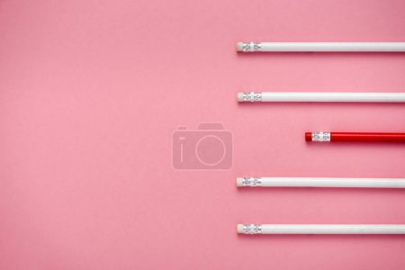 Photo for Top view of erasers on pencils isolated on pink - Royalty Free Image