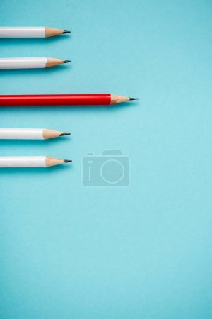 Photo for Top view of sharpened white and red pencils isolated on blue - Royalty Free Image