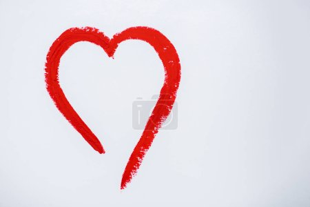 red drawn heart isolated on white with copy space