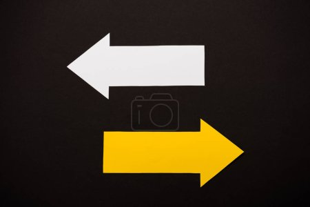 Photo for Top view of directional arrows showing left and right isolated on black - Royalty Free Image