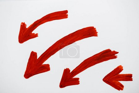 Photo for Red and drawn directional arrows on white - Royalty Free Image