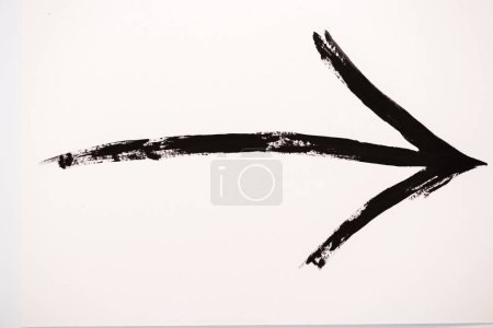 Photo for Black directional arrow on white with copy space - Royalty Free Image