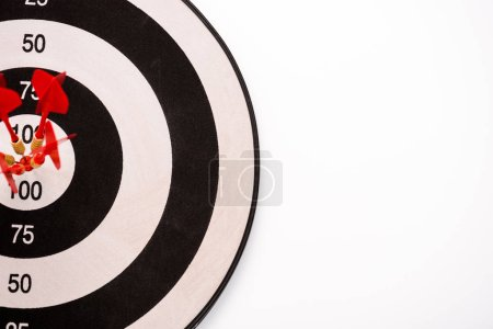 Photo for Top view of black and white dartboard with red arrows isolated on white - Royalty Free Image